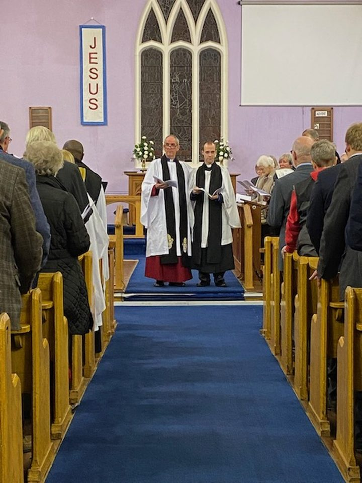 Raymond being welcomed by the congregation