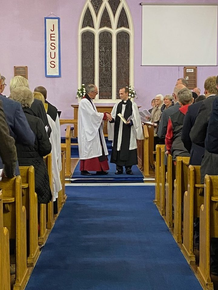 Raymond being congratulated by Archdeacon Roderic West